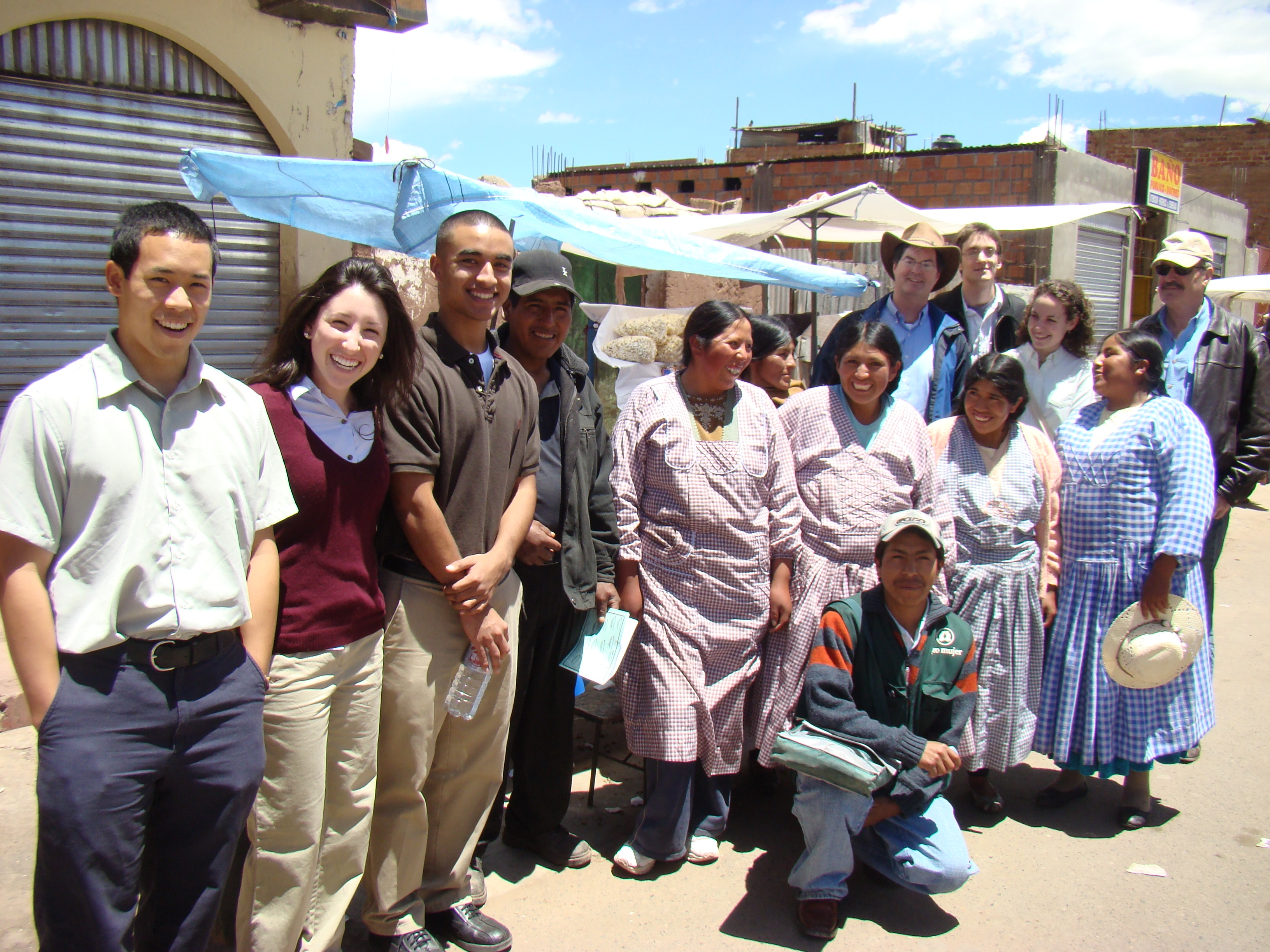 Professor Todd Watkins (back row, third from right) and students with microfinance clients in Peru. Todd Watkins and his students are working on a microfinance textbook.